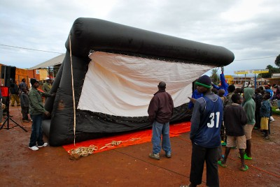 The Hillywood screen inflates at a rural screening site in Rwanda. (Photo courtesy Leah Warshawski)
