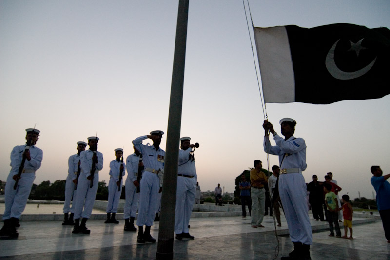 Soldiers lower the Pakistani flag in Karachi. (Photo by Alex Stonehill)