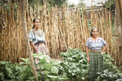 Rising Minds is working with women like Dinora (right) to increase the availability of vegetables in low-income villages. (Photo by Karen Story)