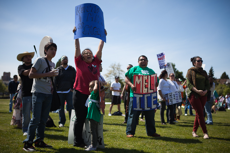 """""""Community to Community"""" volunteer Tara Villalba cheers at the immigration reform rally at Judkins Park on May 1st. (Photo by Ian Terry)"""