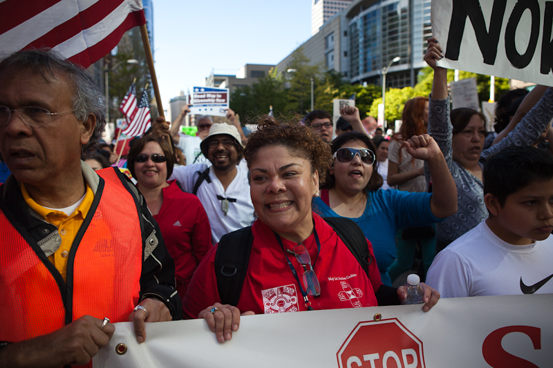 A protester smiles during the immigration reform march on May Day in Seattle. (Photo by Ian Terry)