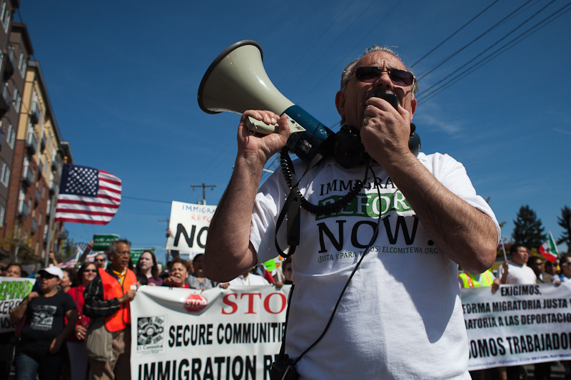 Jorge Quiroga leads the crowd chants during the May 1st immigration reform march. (Photo by Ian Terry)