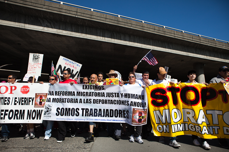 Protesters walk underneath the I-5 overpass on Jackson Street in downtown Seattle during El Comite's May Day march for immigration reform. (Photo by Ian Terry)
