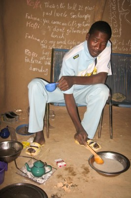 Salif Traore prepares breakfast. (Photo by Kaia Chessen)