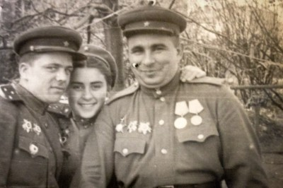 Young Buzya Shapovalova (center) with fellow Russian Army soldiers.