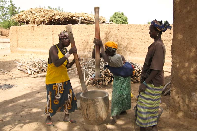 Women in Mali pounding millet. (Photo by Kaia Chessen)