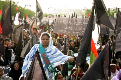 Supporters of the MQM party rally in Karachi in 2009. MQM rallies were targeted by Taliban attacks during the run-up to this year's election. (Photo by Alex Stonehill)