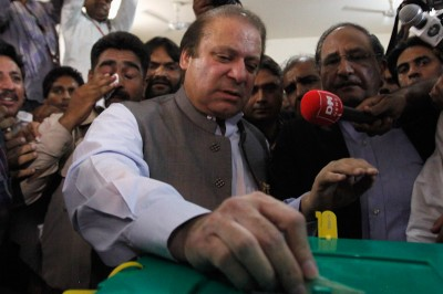 Nawaz Sharif, leader of the Pakistan Muslim League - Nawaz (PML-N) political party, casts his vote for the general election at a polling station in Lahore last week. (Photo by REUTERS/Mohsin Raza)