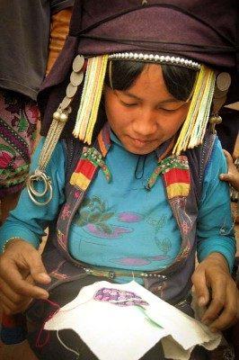 A member of the OckPopTok cooperative in Laos embroidering. (Photo courtesy International Folk Art Market).