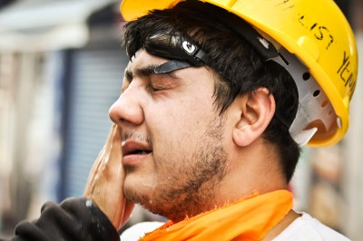 A protester receives first aid after coming into contact with teargas. (Photo by Christan Leonard)
