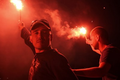 After days of camping out in the park protesters used flares to put on a nighttime firework show to boost morale. (Photo by Christan Leonard)