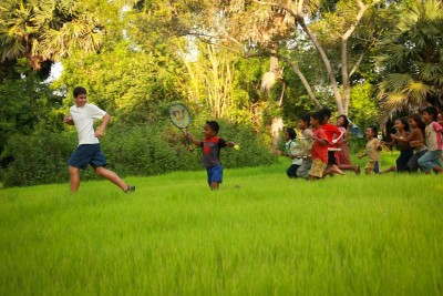 Quincy Briscoe plays with Cambodian children during his stay in Pongro Village in 2008. (Photo by Christopher Briscoe)