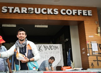 A volunteer handed out food from the patio of the Taksim Square Starbucks in Istanbul, Turkey last week. (Photo by Christan Leonard)