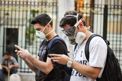 Protesters shared news on their cell phones that police were coming to clear Taksim Square on Tuesday. (Photo by Christan Leonard)
