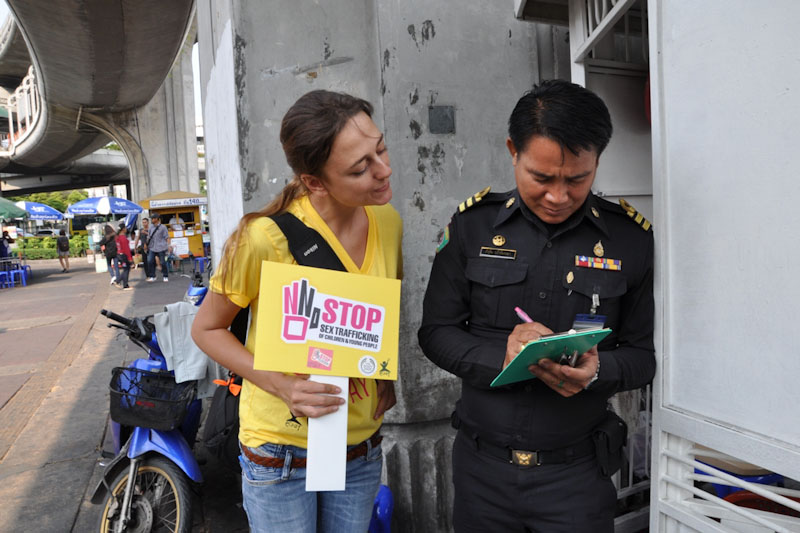 Thai Policeman signing ECPAT's and The Body Shop's 'Stop Sex Trafficking of Children and Young People'  campaign petition. (Photo courtesy ECPAT International)