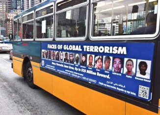 The controversial ad, show mugshots of 16 of the 31 people on the FBI Most Wanted Terrorists List. (Photo by Alex Stonehill)