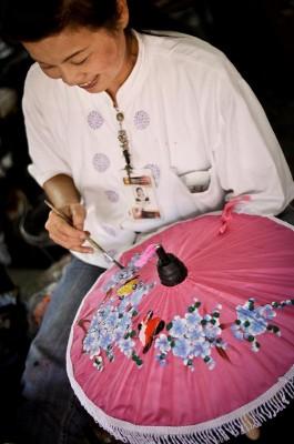 An artisan paints an umbrella at a factory outside Chiang Mai, Thailand. (Photo by Marat Garafutdinov)