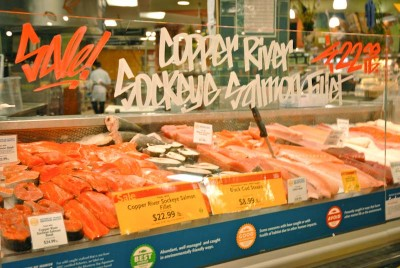 A Boston company is awaiting FDA approval of genetically modified Atlantic salmon, which used a growth hormone from the Chinook salmon to increase the speed of the fish's growth. Whole Foods (pictured here) has already committed to never offering the GM salmon, and the Seattle City Council passed a resolution opposing the salmon. (Photo by Rebecca Randall)