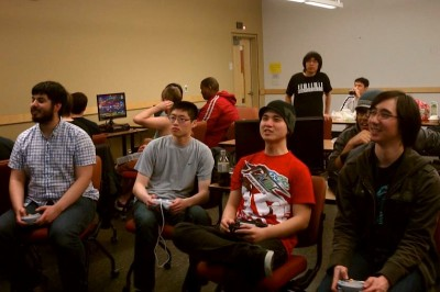 Members of SRKUW including Paul Ostermann (far right) play fighting games competitively every Friday night. (Photo courtesy SRKUW)