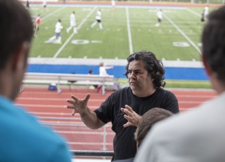 Sam Hassan gathers players from all the teams competing in the upcoming All Nations Cup Tuesday at Shoreline Stadium. Based on the World Cup of soccer, the tournament brings together local athletes of different nationalities for a two-week tournament. (Photo by Dean Rutz / The Seattle Times)