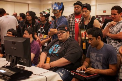 Gamers from around the globe go head to head at the Evo fighting video game competition in Las Vegas on July 13th, 2013. (Photo by Singh Lion )