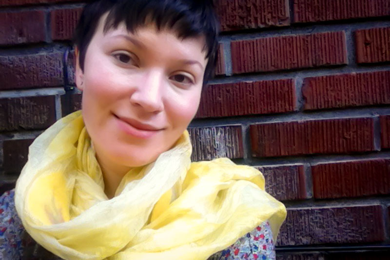The author, with the scarf her mother bought her from a nonprofit for women with disabilities in Kazakhstan. (Photo by Marat Garafutdinov)