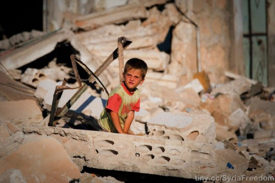 A child surveys the damage to his family's house in Idlib, Syria after it was bombed by Assad warpalnes (Photo from Freedom House via Flickr)