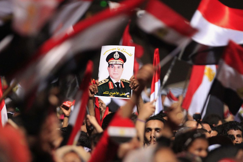 Protesters in July calling for the ouster of Mohamed Morsi hold a photo General Abdel Fattah al-Sisi. (Photo from REUTERS/Mohamed Abd El Ghany)