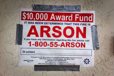 A sign posted outside Med Mix soliciting tips on the yet unsolved arson case. (Photo by Alex Stonehill)