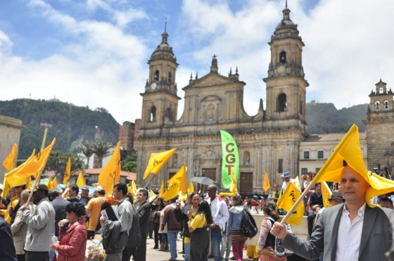 Protesters in Colombia march on Bogota's central plaza, demanding the government to change its economic policies, which coffee farmers say are hurting their wallets. (Photo by Wesley Tomaselli)