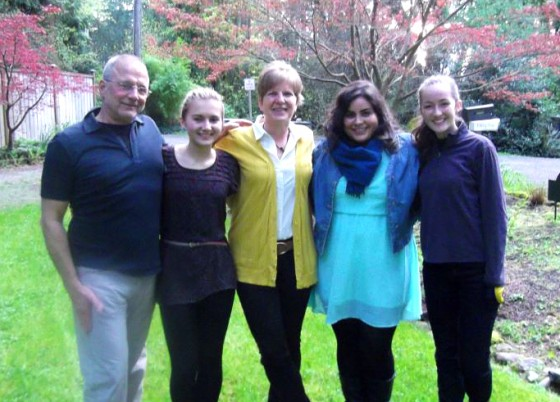Hannah (second from left) and her family host visiting Tunisian journalist Arwa Kooli in Seattle. (Photo courtesy of Myrick family)