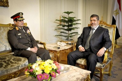 Mohammed Morsi (right) during happier times with his Defense Minister General Sisi, who deposed him in July. (Photo via The Egyptian Presidency)