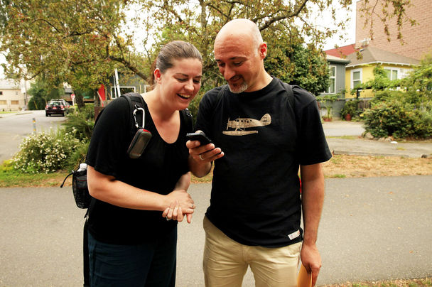Stephanie Weber and her husband, Pier Paolo Perrone, of Frankfurt, Germany, look for clues to find a geocache in Seattle's Fremont neighborhood on Wednesday. (Photo by Erika Schultz / The Seattle Times)