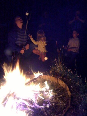 Toasting smores around a campfire July 4th. Photo by Frederica Jansz.