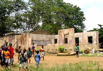A school in Koindu damaged by RUF rebel forces during the Sierra Leone Civil War. (Photo from USAID via Wikipedia)