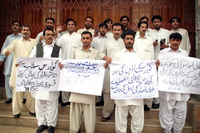 Muatasim Qazi (front row, center) protesting at the Quetta Press Club in 2010 for relief efforts in flood affected areas. One of his fellow protestors, a social worker and rights activist, was killed the following year. (Photo courtesy Muatasim Qazi)