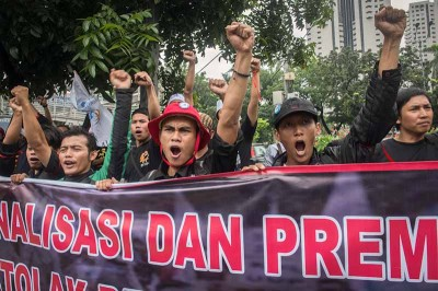 Unionized metal workers hold a demonstration over pay in Jakarta last January. (Photo by Branden Eastwood)