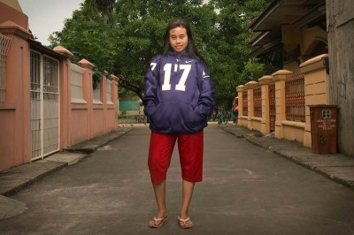 Anissa wearing the UW jersey she helped produce. (Photo by Branden Eastwood)