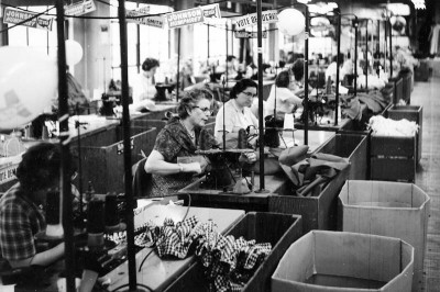 A garment factory in the U.S. in 1964, long before international trade barriers were removed. Today labor costs in the U.S. are more than 20 times higher than in Southeast Asia. (Photo courtesy The Kheel Center)