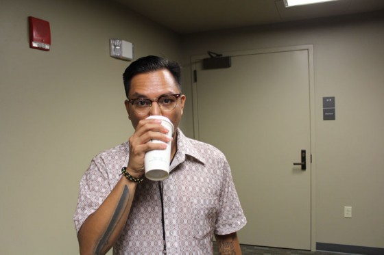 Guest Judge Prometheus Brown (aka Geo Quibuyen) sips coffee during intermission.