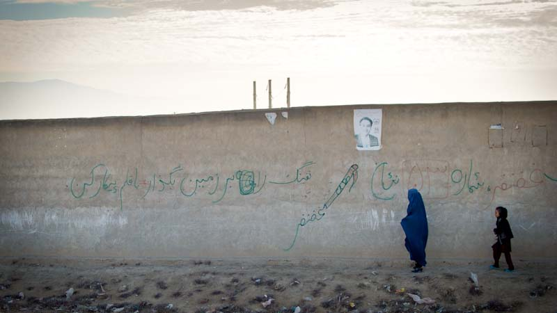 """Lay down your arms; fight with the pen"" in northern Afghanistan. (Photo by Dean Chahim)"