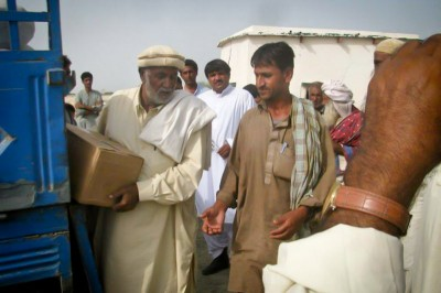 Relief supplies are delivered to earthquake victims in Awaran. Pakistan's military is coordinating relief efforts but international relief organizations have not been allowed to provide direct aid. (Photo courtesy Hina Baloch)