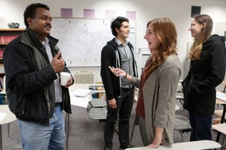 """Abdi Mohamed Ali, left, helps Rachel Eagan pronounce Somali words in an evening class held Tuesday at Foster High School. """"You need to speak to Somalis,"""" to learn, Ali says. (Photo by Bettina Hansen / The Seattle Times)"""