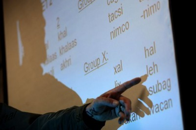 Instructor Doug Person points to the screen during the Somali class held in Tukwila. Registration is still open for fall classes. (Photo by Bettina Hansen / The Seattle Times)