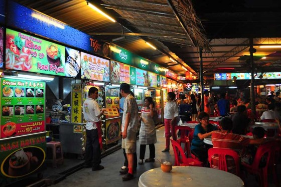 Food hawker stalls in Pulau Penang, Malaysia, where customers by food from individual stalls and then eat in a communal dining area, or at home. (Photo by Davidlohr Bueso via Flickr)