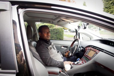 Andualem Bahru, who immigrated to the United States from Ethiopia in 2005, began driving for UBER this past April after driving a Yellow Cab for six years. (Photo by Jillian Stampher)