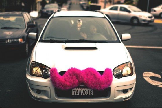 "A Lyft driver in San Francisco, where many of the ride-share services originated. (Photo by <a href=""http://www.flickr.com/photos/bootleggersson/"">Alfredo Mendez </a>via Flickr)"