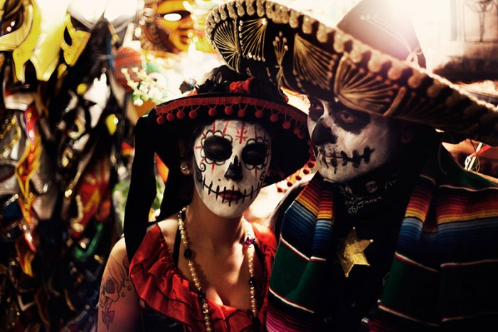 Holiday participants paint their faces as skulls. (Photo via Flickr by Rob Sheridan)