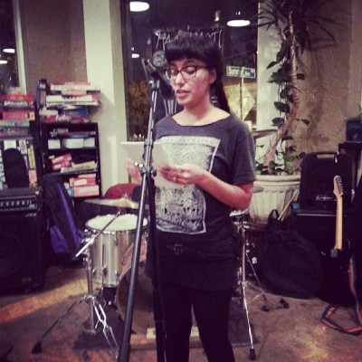 "Nyky Gomez reading in Seattle at Black Coffee Co-op last week (Photo via <a href=""http://instagram.com/poczineproject"">POC Zine Project </a>)"