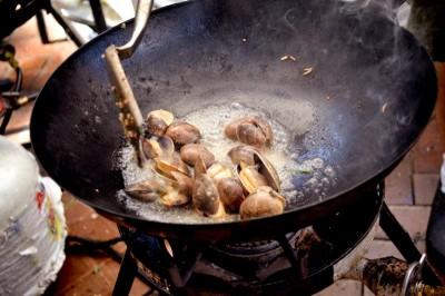 Manila clams prepare to become curry. (Photo courtesy Kedai Makan)